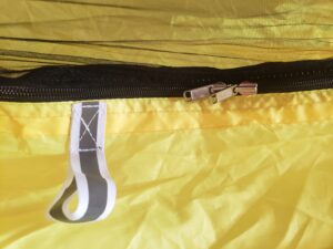 Reflectorized guyouts and reversible zippers of Ora 11.